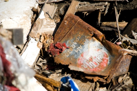 old rusted can amongst other debris