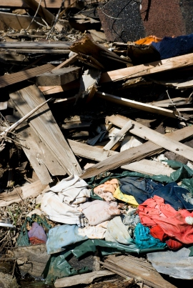 pile of wood, pile of fabric, collapsed building