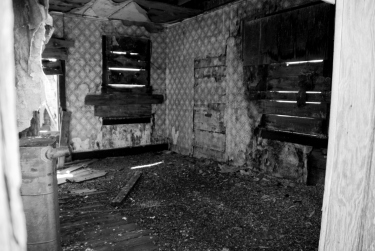 interior of a crumbling abandoned house