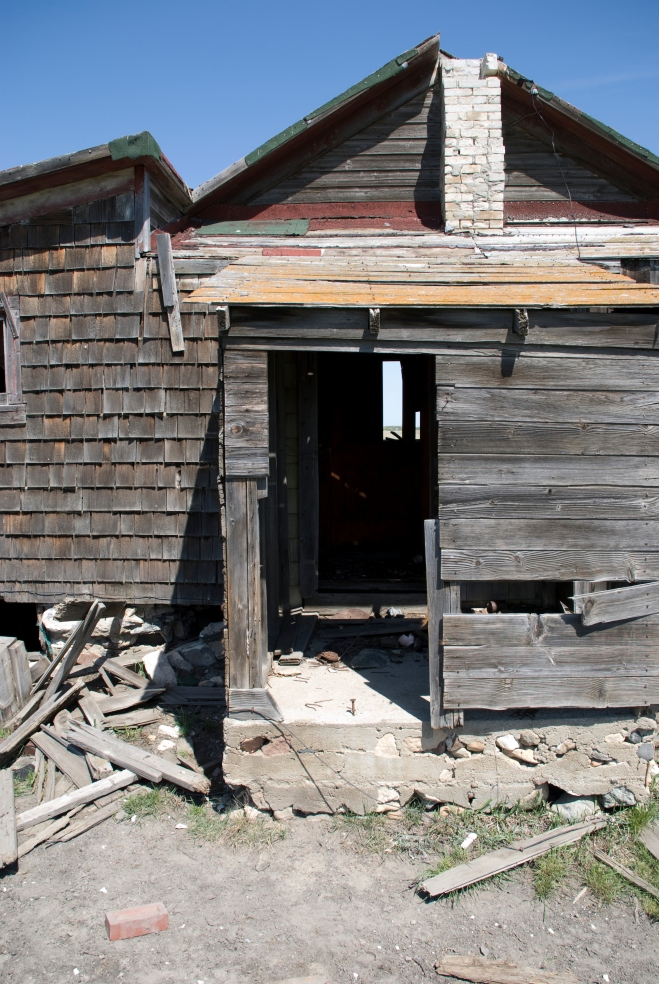 abandoned house with wood siding
