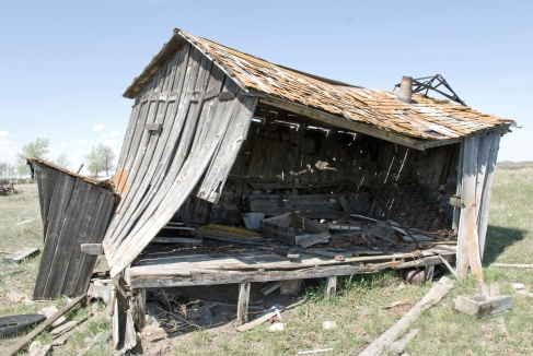 collapsing wooden shed