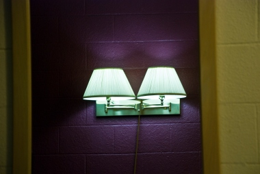 lamps reflected in motel mirror