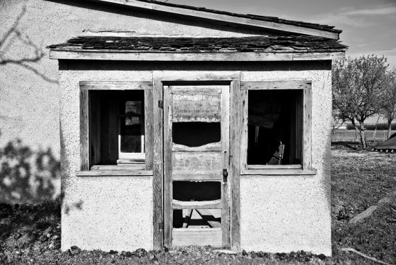 broken door and windows on an abandoned house