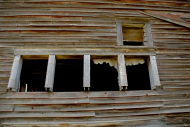 side of abandoned barn