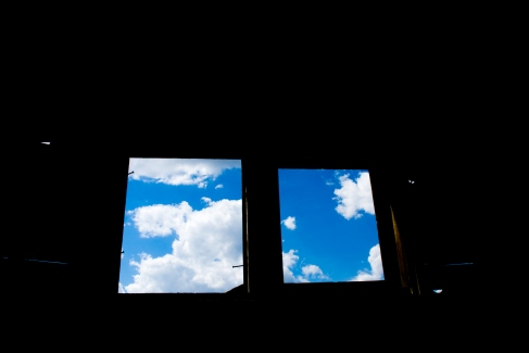 windows, looking out at blue sky with clouds