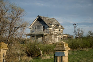 abandoned house and windmill