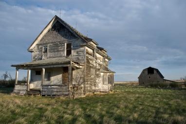 abandoned house and barn