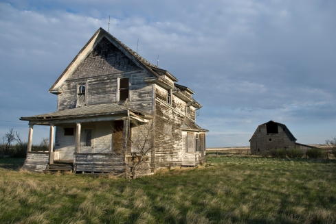 abandoned house and barn
