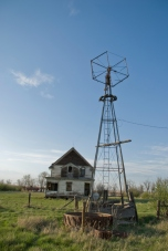 abandoned windmill and house