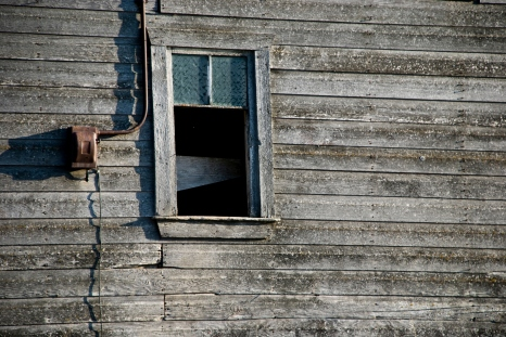 window with old wood siding