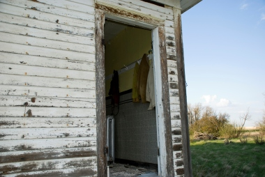open door with sweaters hanging inside
