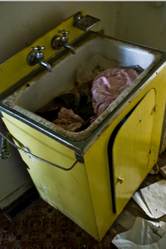 old sink filled with garbage