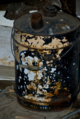 old rusted Esso canister