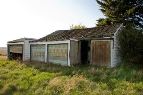 abandoned three-door garage