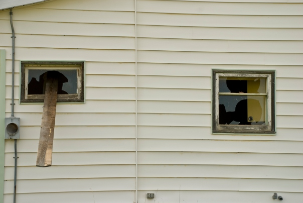 broken windows on abandoned house