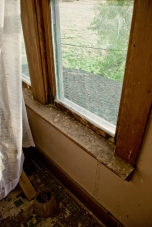 dirty windowsill in an abandoned house