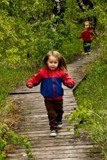 two children on a wooden walkway