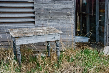 old side table outside of abandoned house