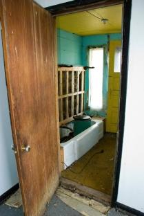 crumbling bathroom in abandoned house