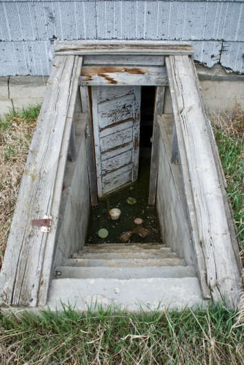 stairway to flooded basement, abandoned house
