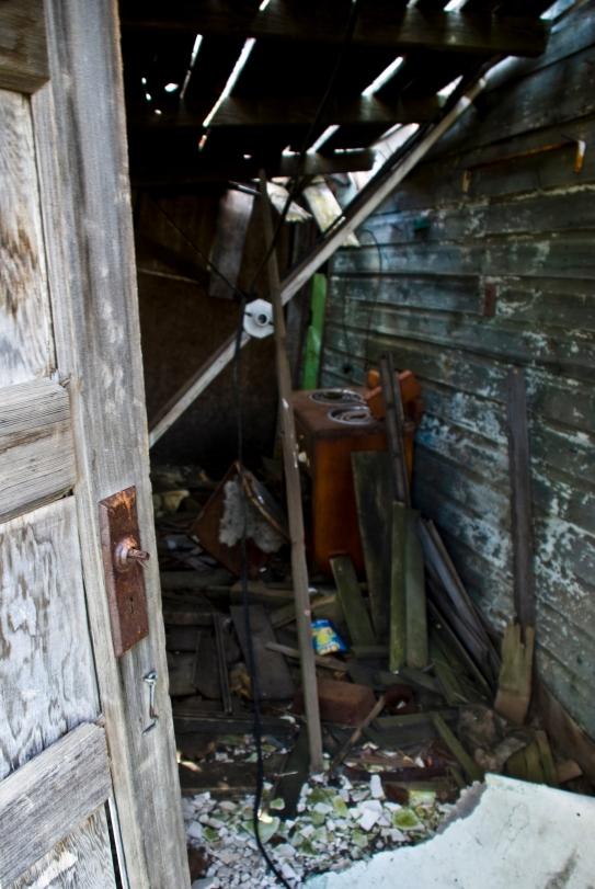 interior of crumbling house, debris