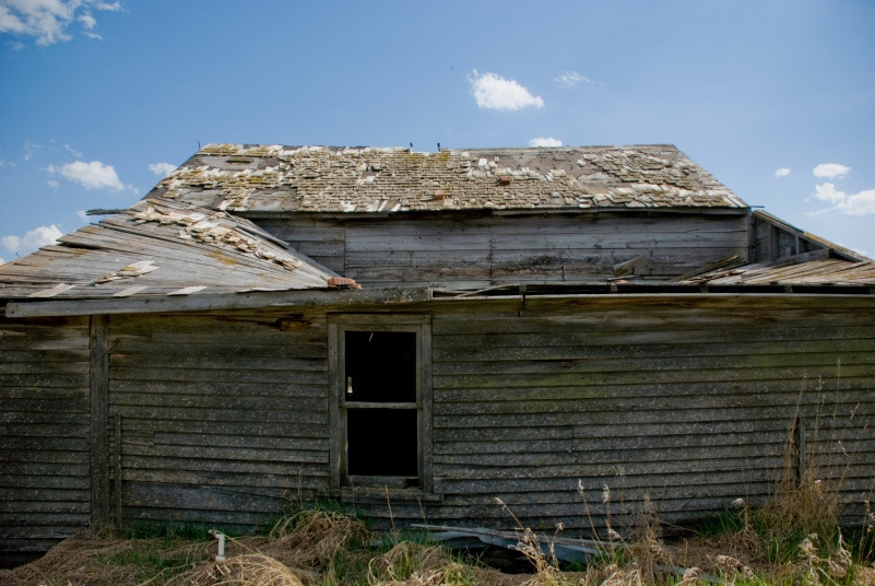 roof collapsing on abandoned house