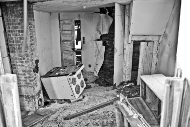 interior of abandoned house, overturned stove