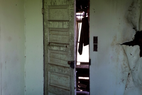 interior of abandoned house, old wooden door