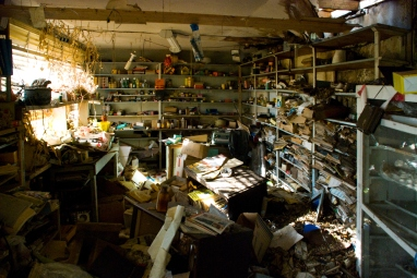 interior of abandoned post office, piles of paper debris