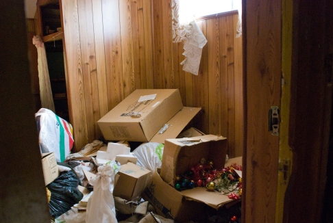 discarded boxes in wood-tiled room