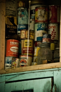 old cans of glues and enamels