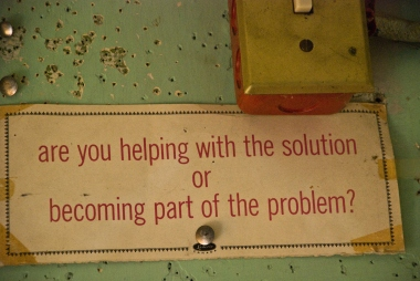 old sign - are you helping with the solution or becoming part of the problem?