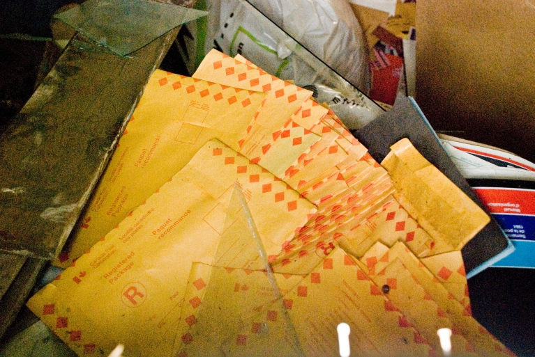 pile of old envelopes with broken glass