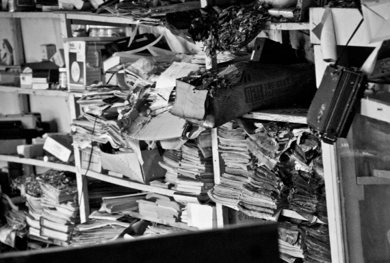 piles of books and paper in old post office