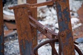 rusted metal on the base for an old singer sewing machine