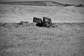 old truck and car in a field