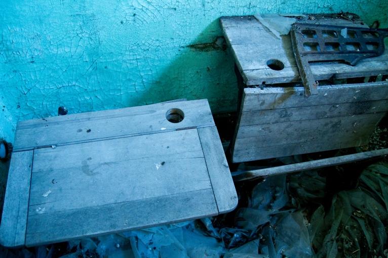 old desks in abandoned school