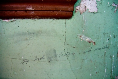 pencil on cracked wall, says - stop, look, list, and smell