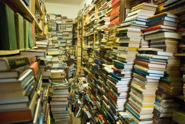 piles and piles of books in bookstore