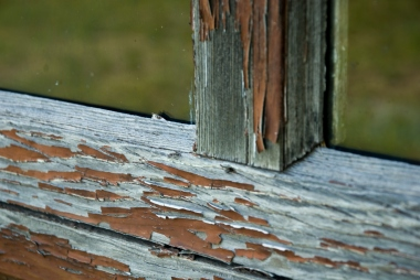 close-up of peeling paint on old building