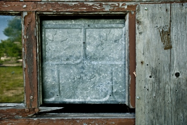 window pane replaced with metal