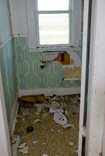 debris on floor in abandoned house