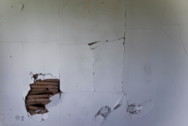 hole in wall and cracking paint