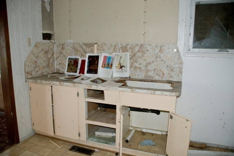 musical diagrams in crumbling kitchen