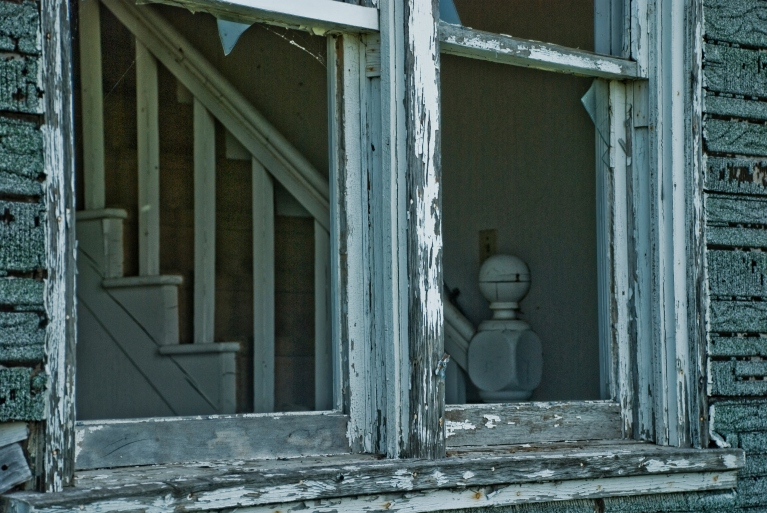 window into an abandoned house, stairway inside