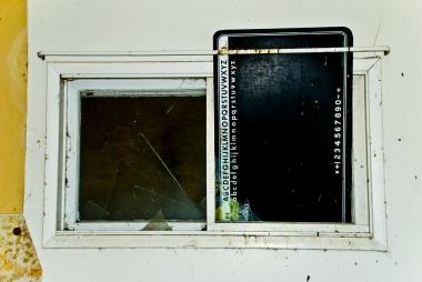 blackboard placed inside a broken window