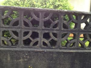 a concrete fence with circles and squares