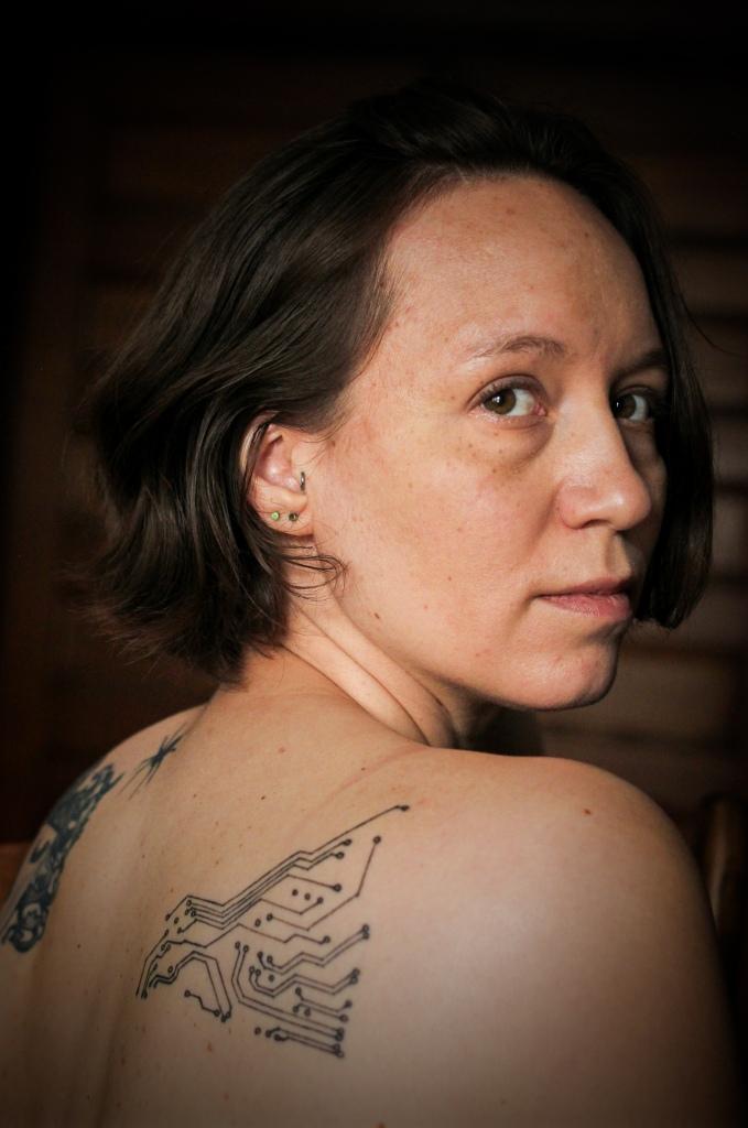 headshot showing cyborg circuit tattoo