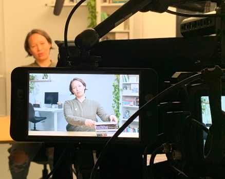 author reading viewed through a video camera